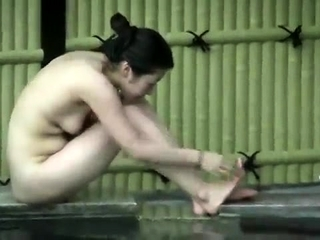 Amateur Japanese girl gives public handjob